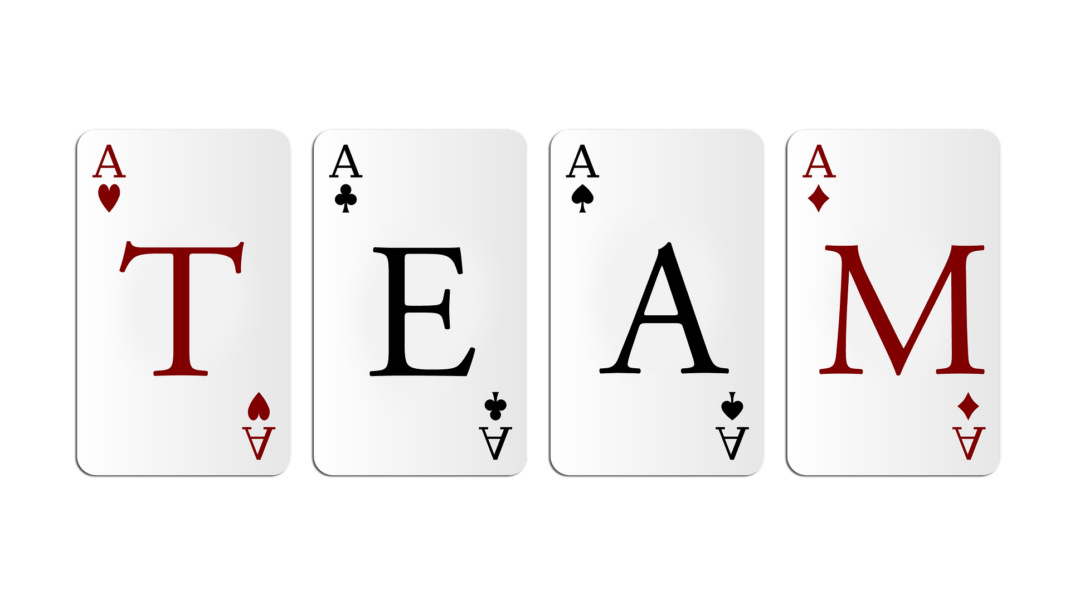four AS playing cards with TEAM lettering